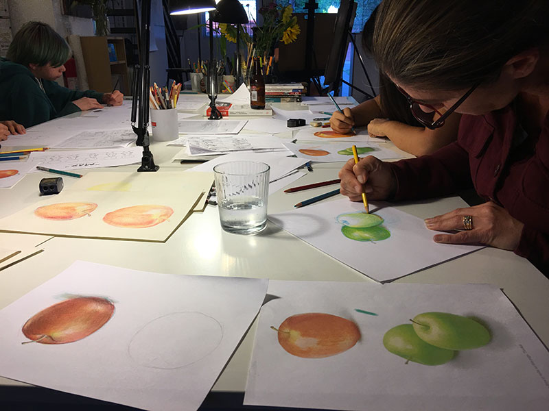 "Using Prismacolor pencils to layer primary colors, Rachel worked to ""acquire the true notion of the form"" of apples."