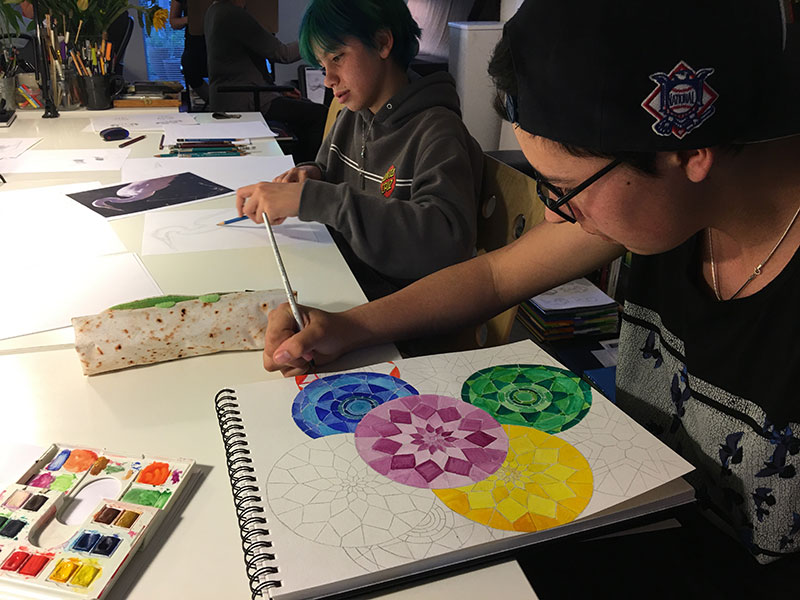 You know you've found the right drawing crowd when you can take a break, walk around the studio, and get inspired by the outrageously cool projects everyone is working on. Dylan adds watercolor to his drawing as Amma confidently sketches an egret during Wednesday's Drawing Lab session.