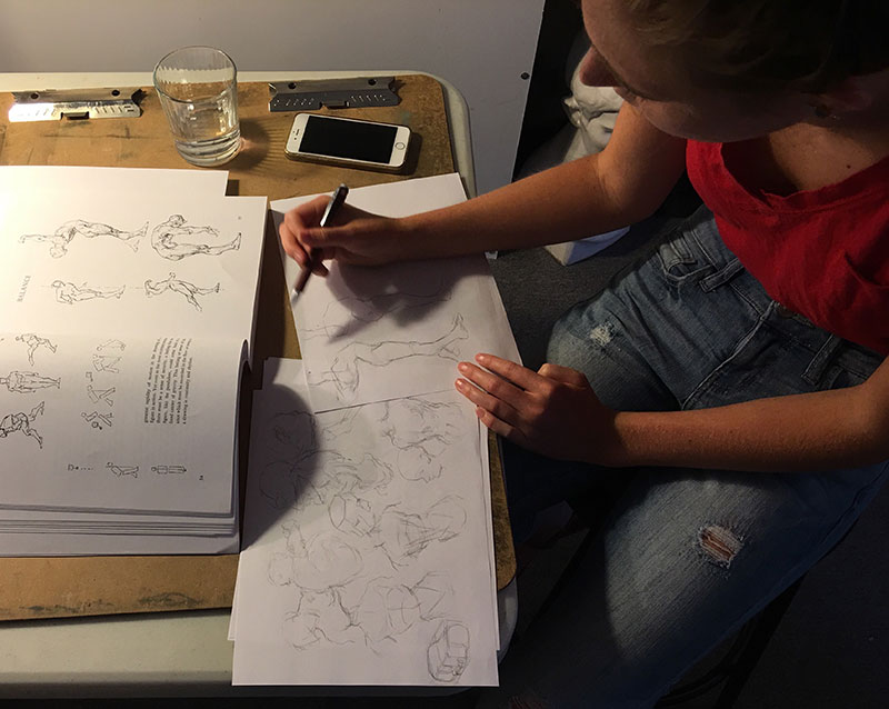 Between work and preparing for Cabrillo College, Faith delves into figure studies from George Bridgman's book, Drawing from Life as she develops characters for an illustrated story she is doing.